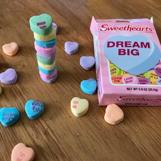 candy heart stacking, one of the fun Valentine's Day activities