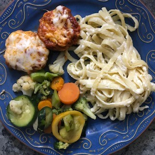 fettuccini alfredo with chicken parmesan mini meatloaves, one of the cold weather make ahead meals