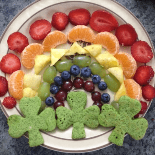 St. Patrick's Day pancakes with a fruit rainbow