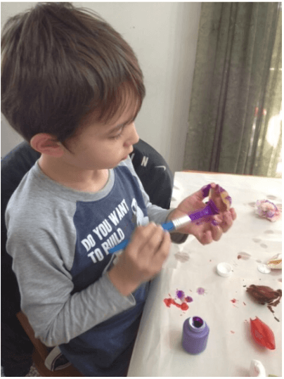 Painting shells for the shell pasta crafts